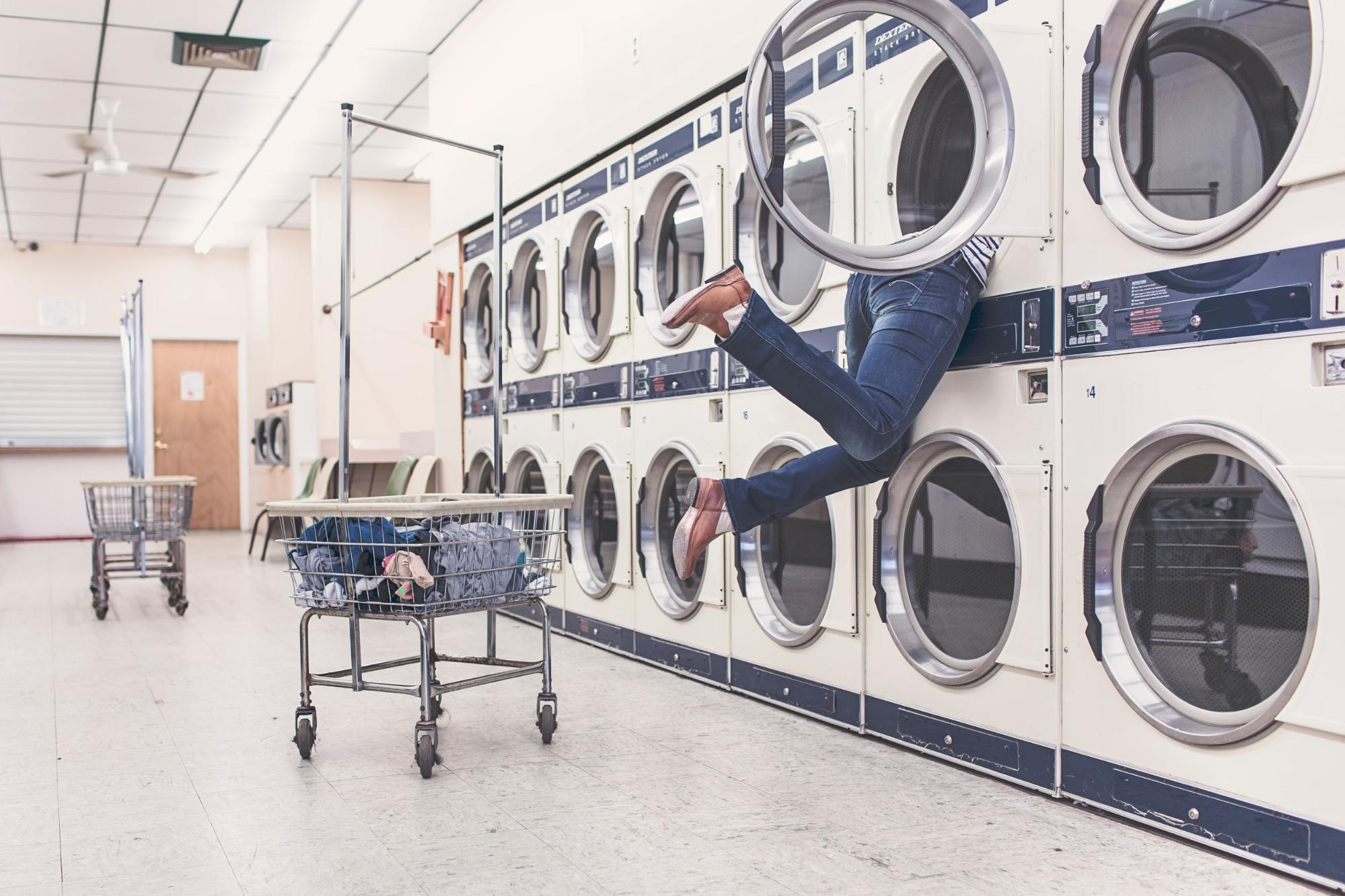 person reaching into dryer