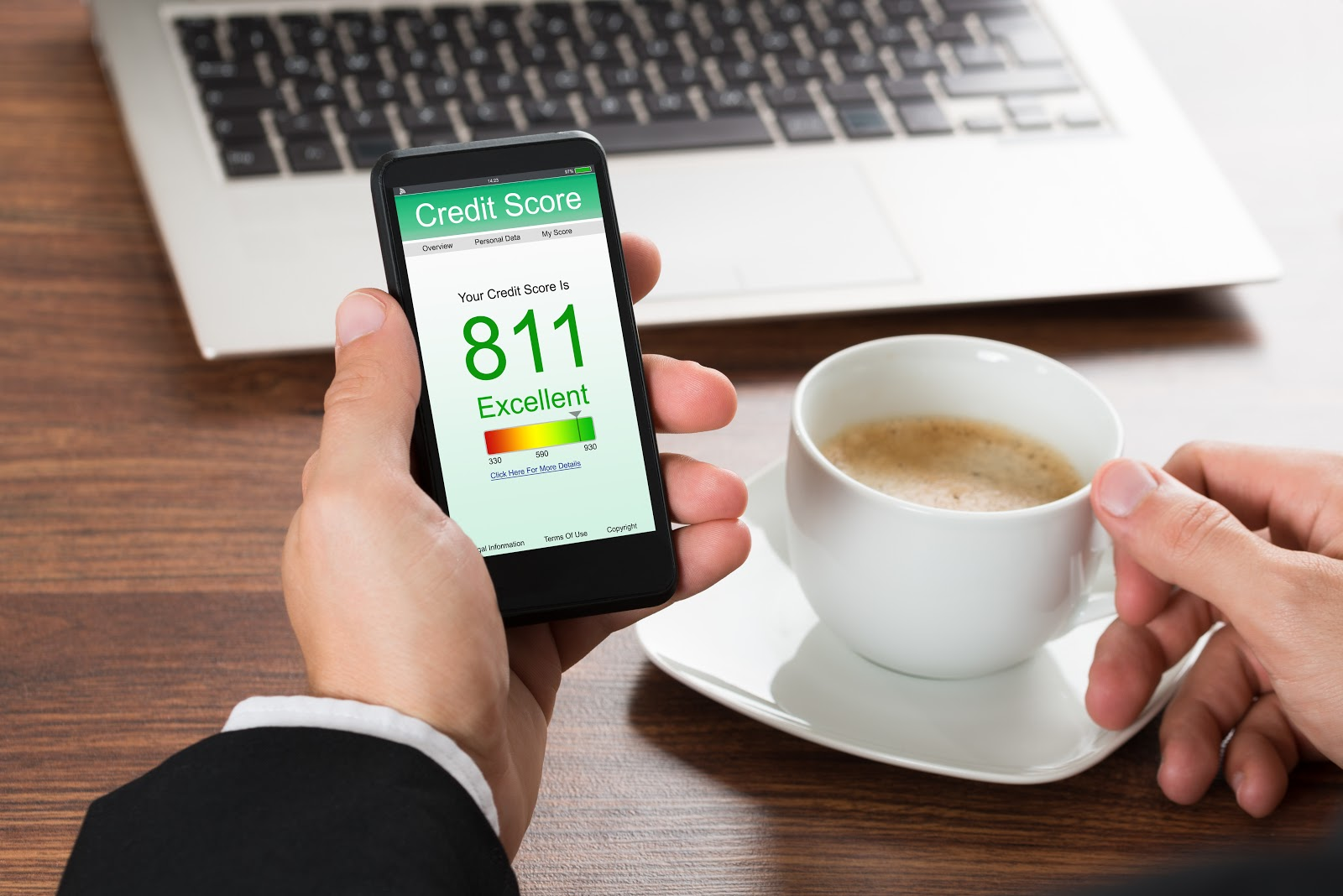 Close-up of a phone displaying a credit score