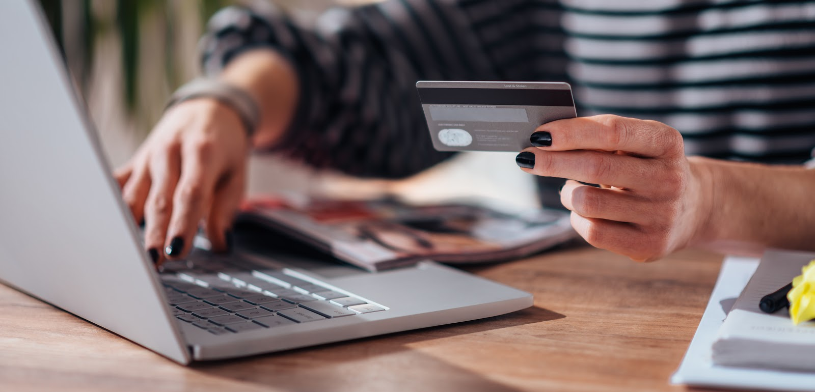 how to get out of credit card debt: Close-up of woman shopping online