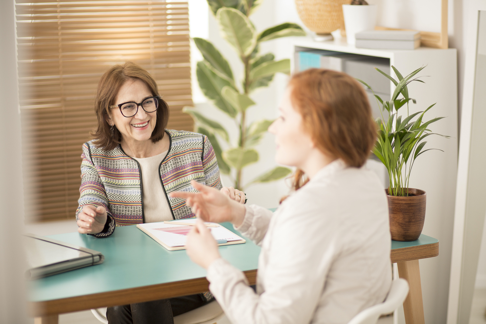 Best debt relief: A woman speaks with a financial advisor
