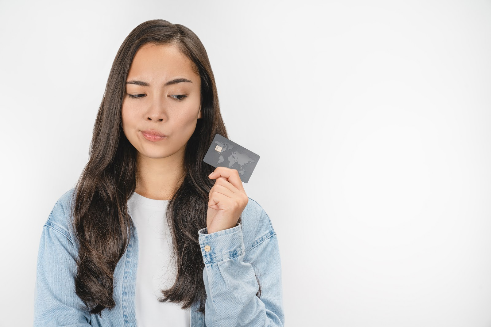Woman holding a credit card