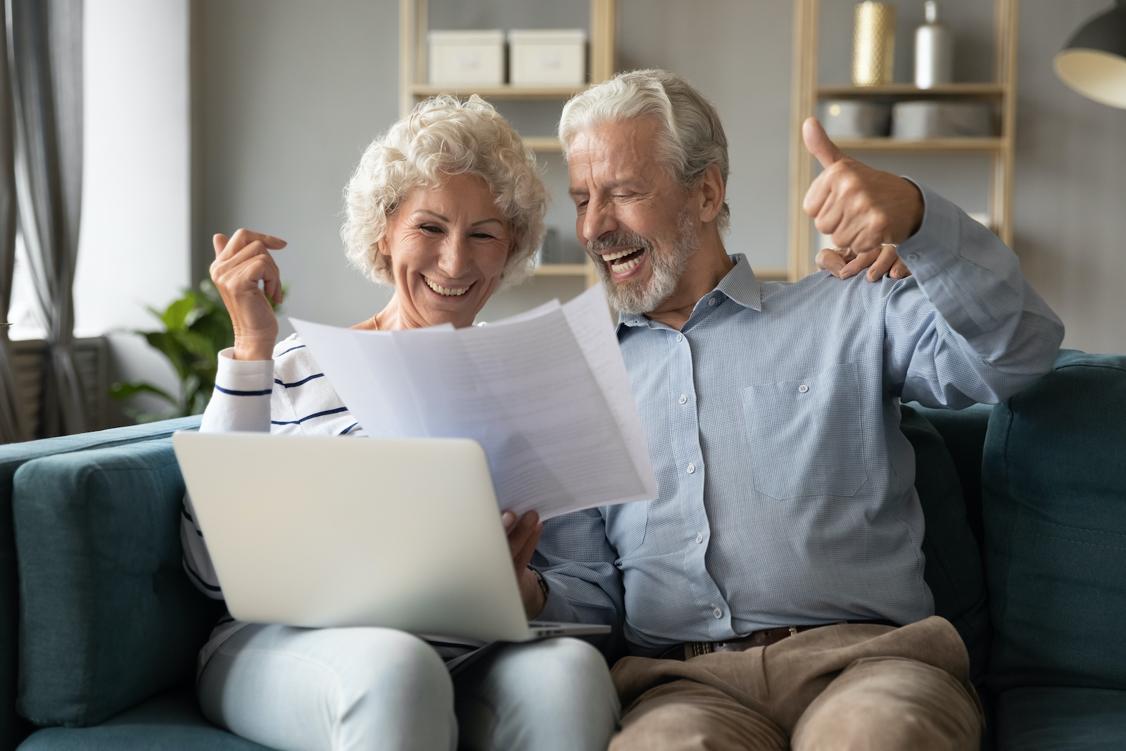 How long will it take to pay off my credit card: An older couple celebrates while looking at their credit card bill