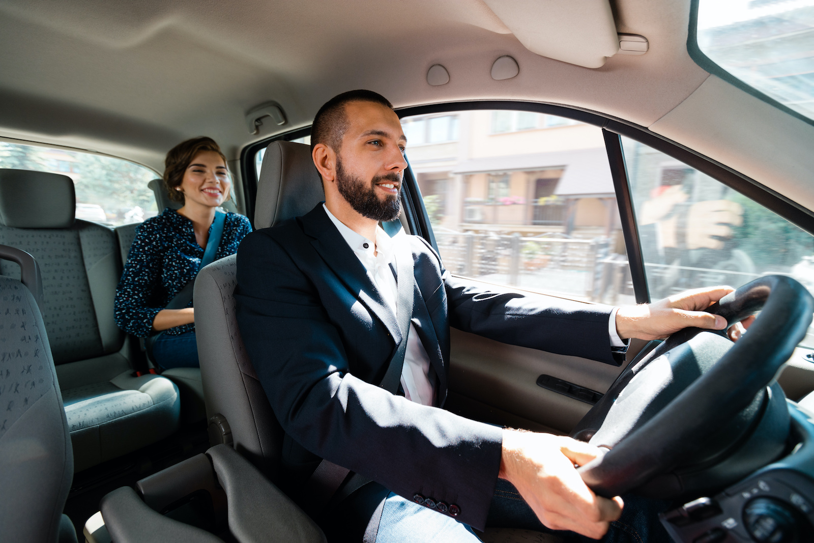 What to do when unemployed: A man works as an Uber driver