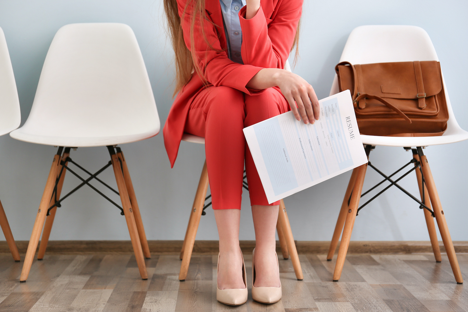 What to do when unemployed: A woman sits, waiting for an interview