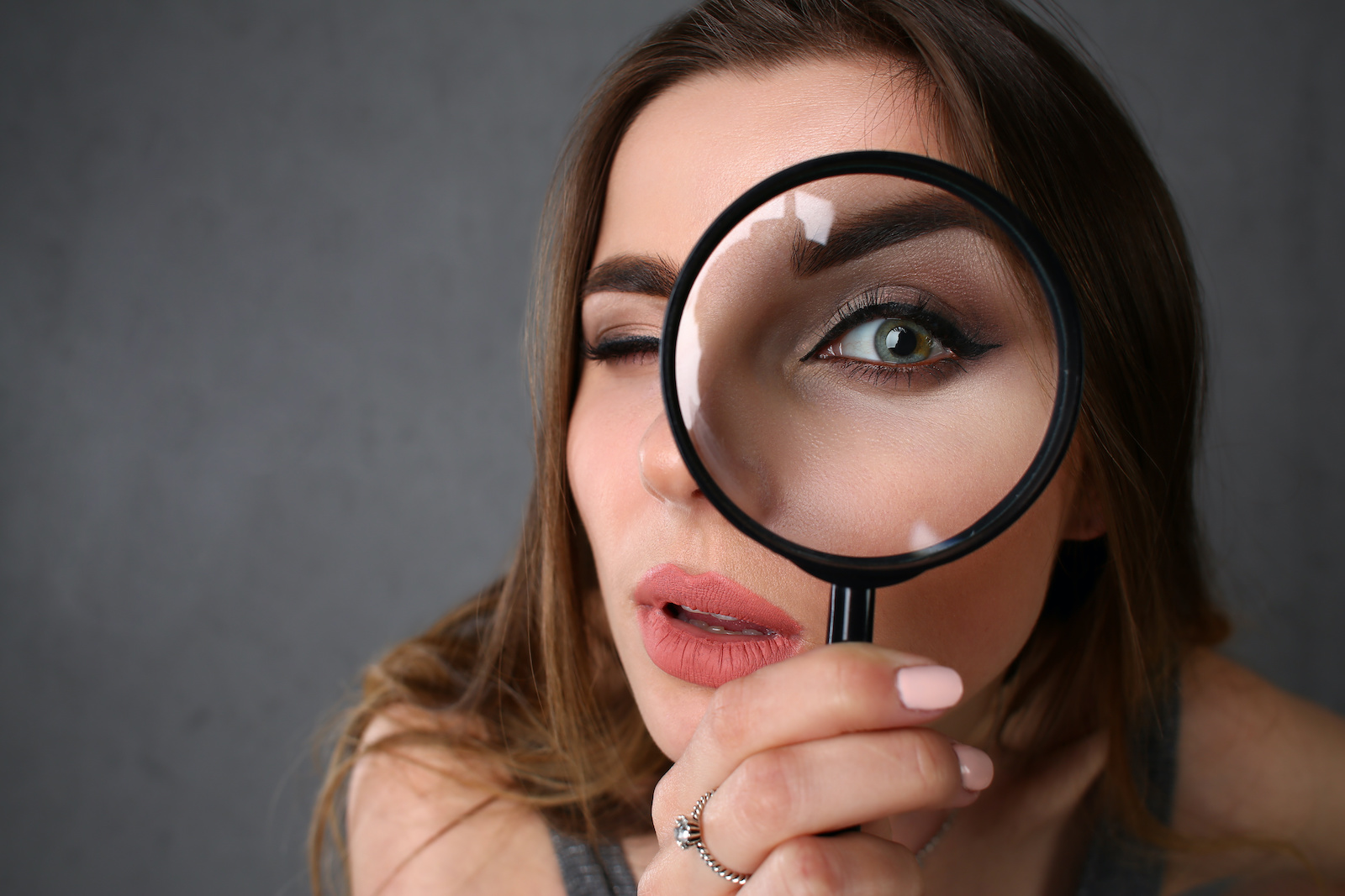 Soft credit check: A woman inspects something with a magnifying glass