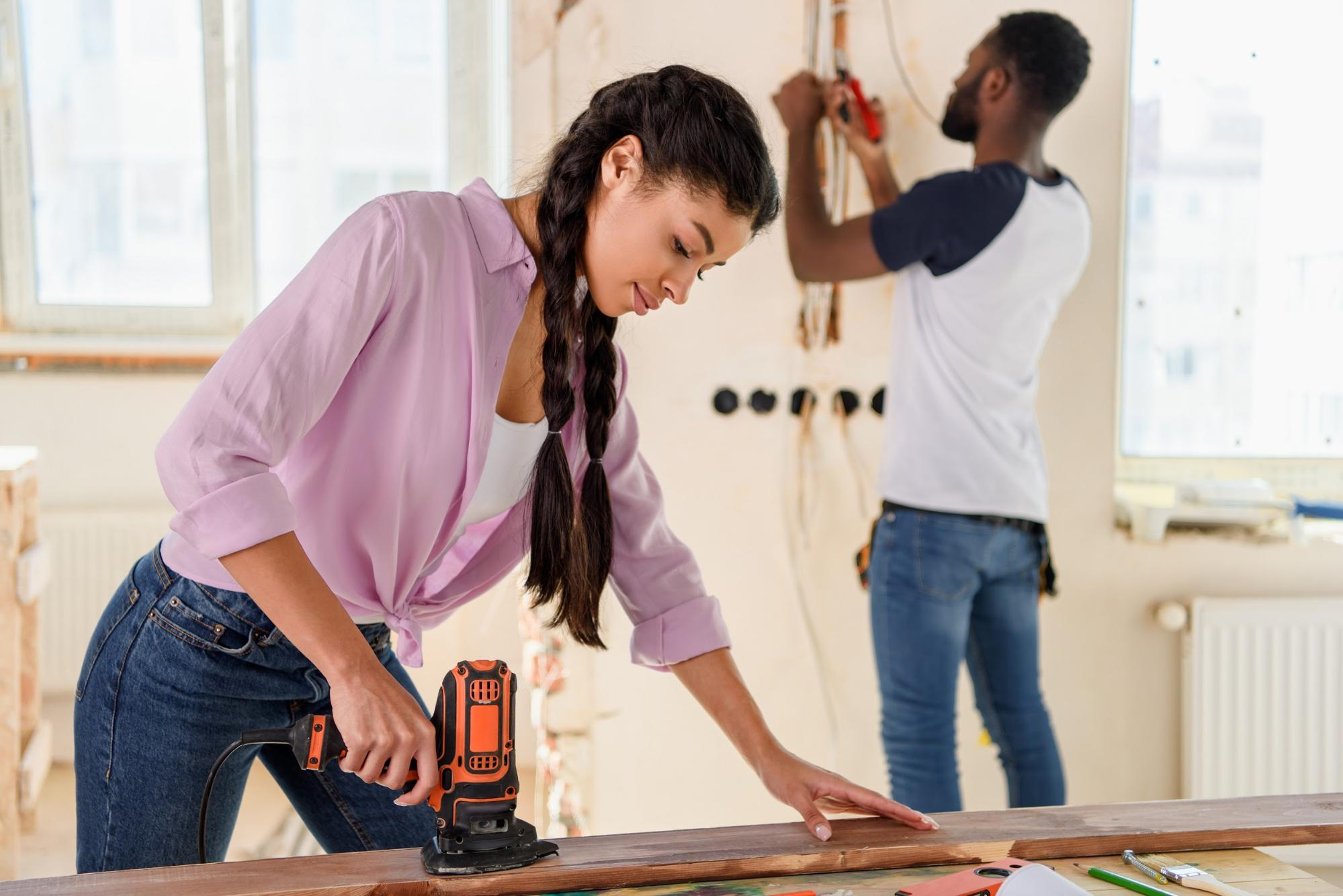 Man and woman renovate home together