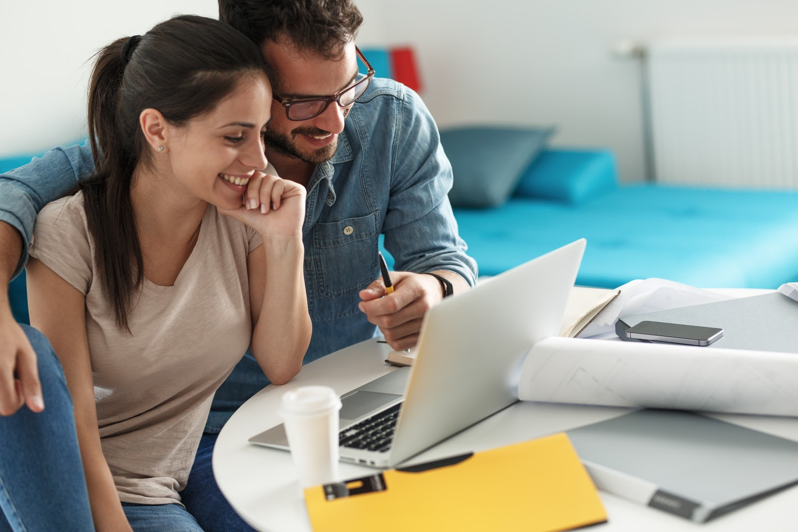 What is a line of credit: Couple with computer reviewing bills