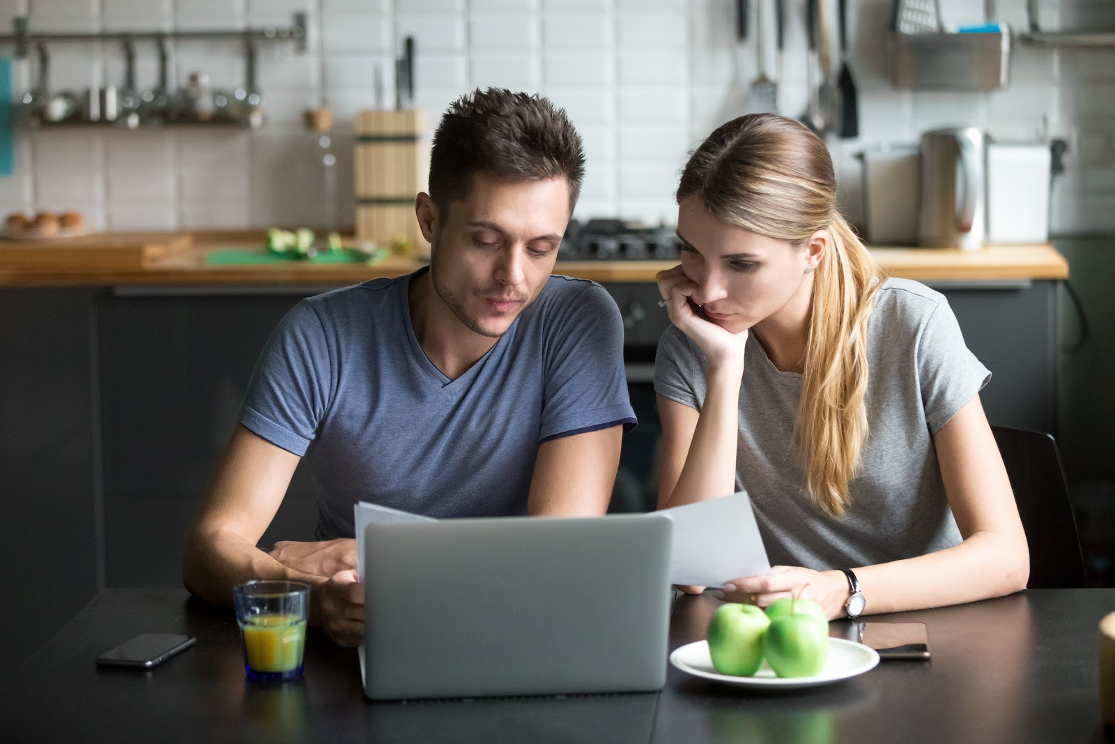 Couple at laptop figuring out budgeting tips