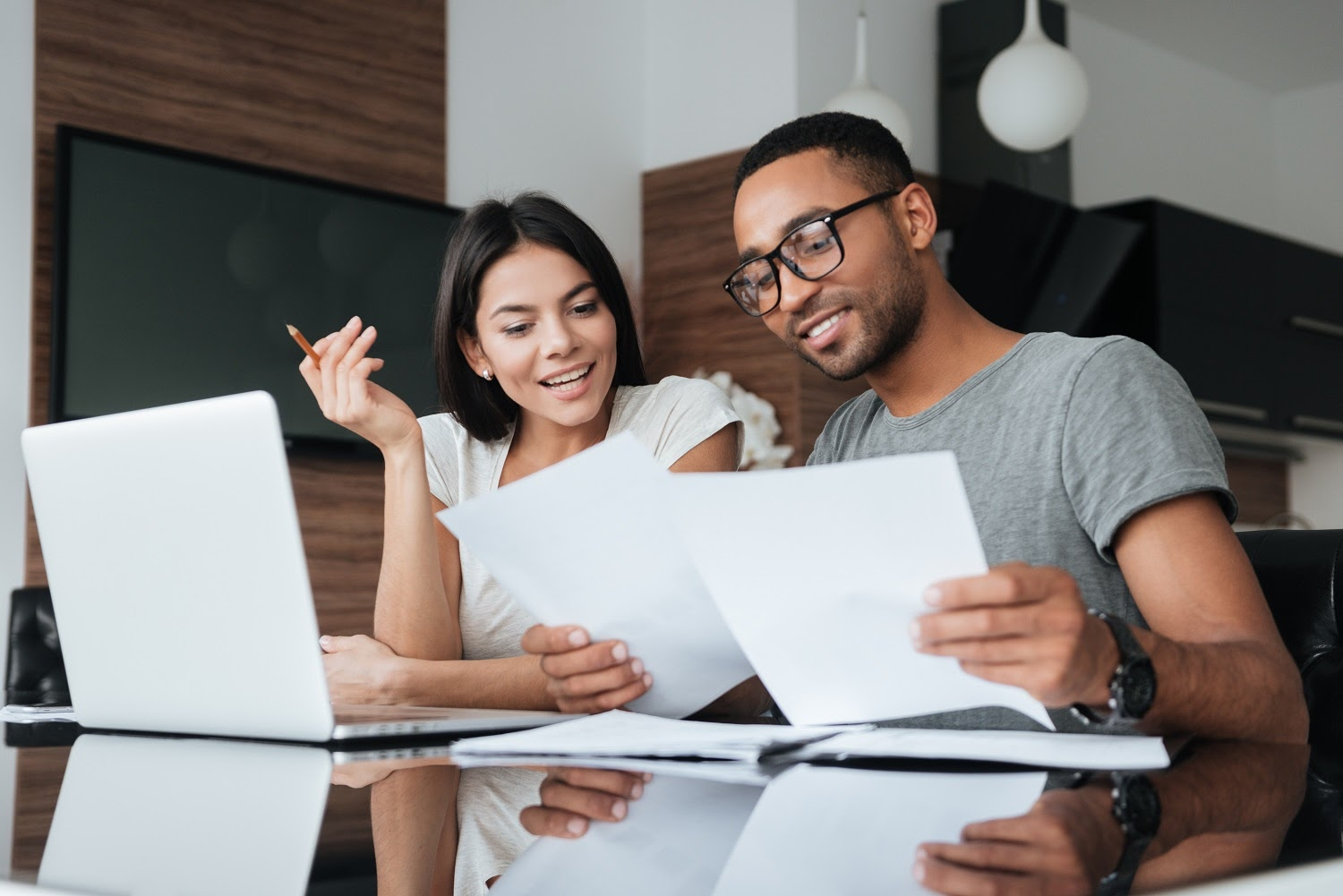 Couple reviewing bills and considering a line of credit