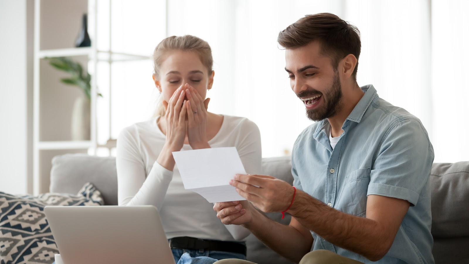 What credit score do you start with: Happy couple looking at credit report