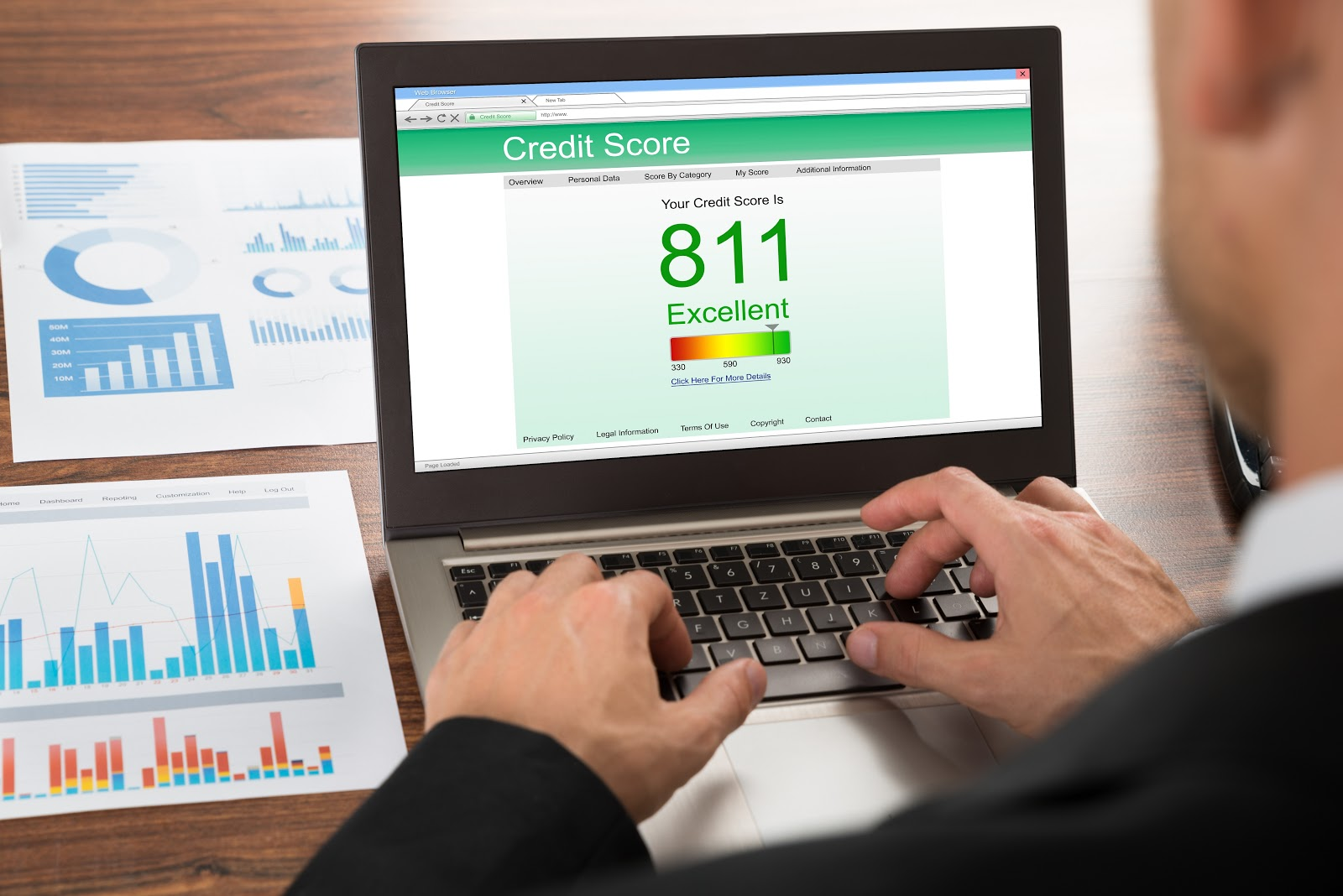 Close-up of businessman checking credit score on laptop