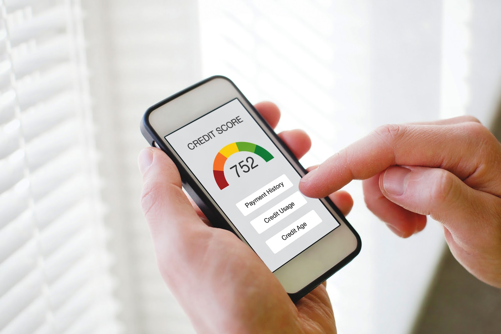 Smartphone displaying a credit score smartphone