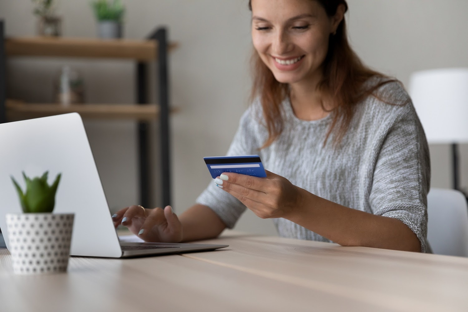 Woman paying credit card online