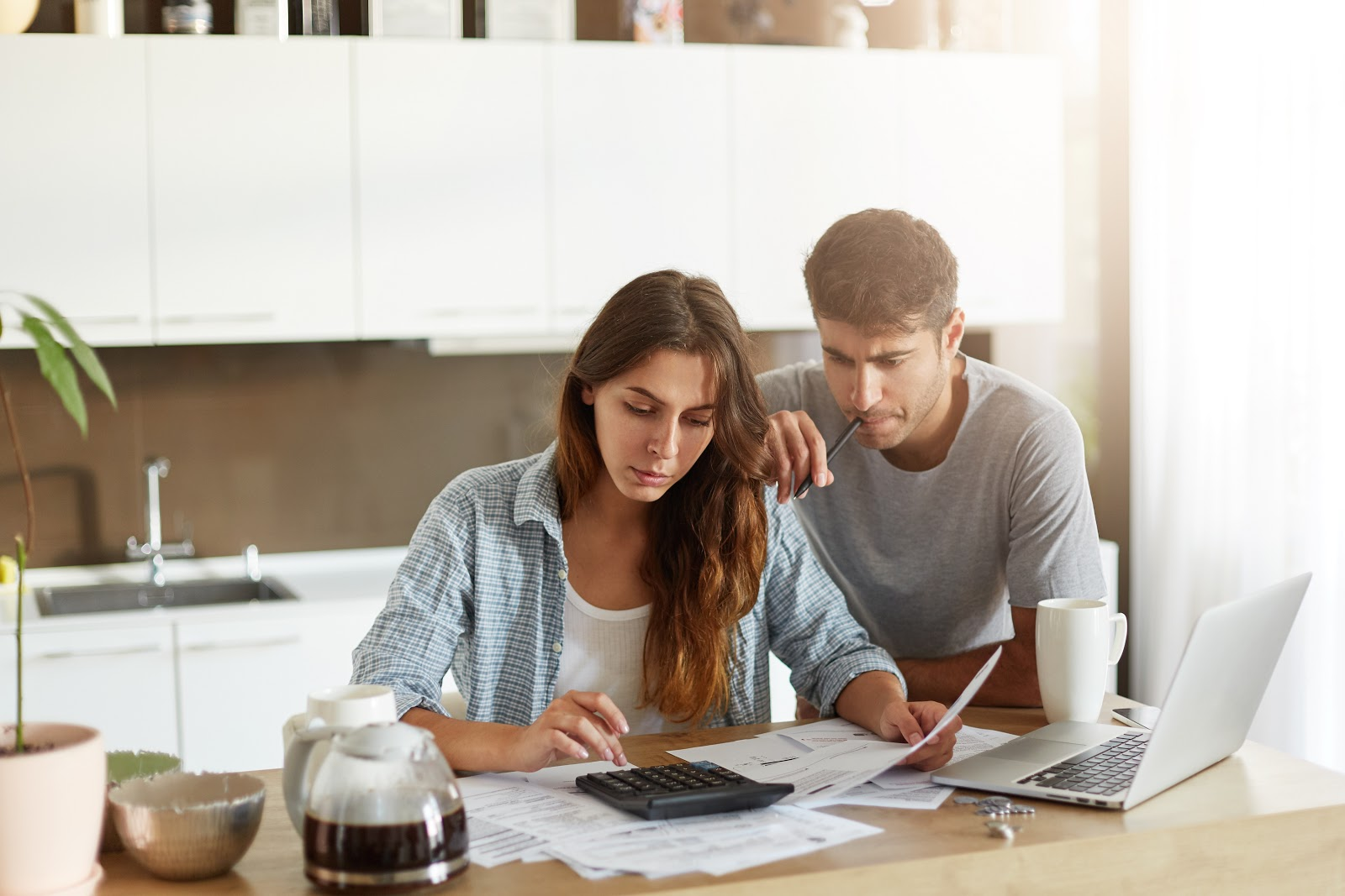 Young couple reviewing financial documents