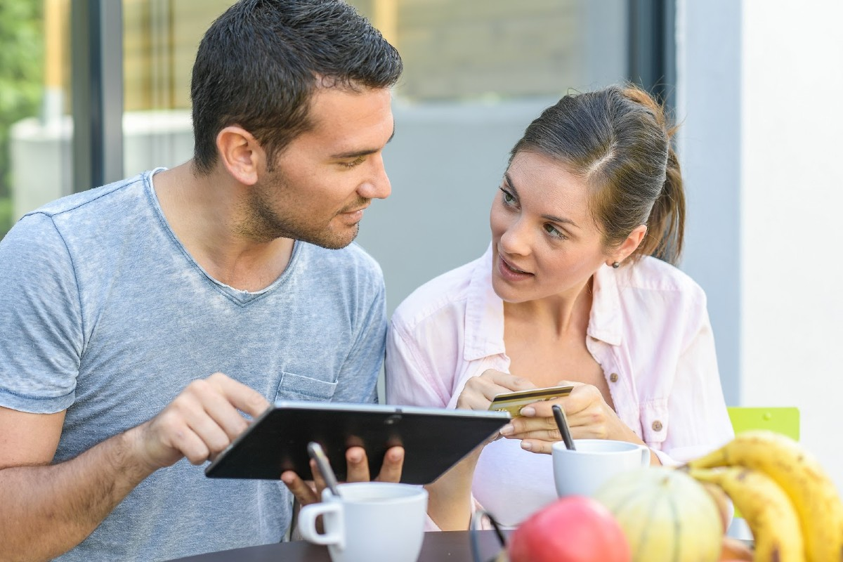 Couple reviewing finances with tablet