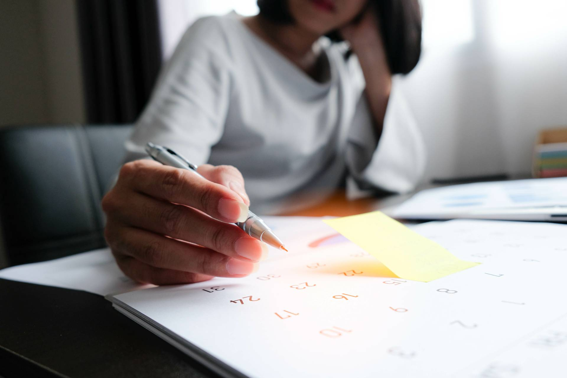 Woman with calendar figuring out finances