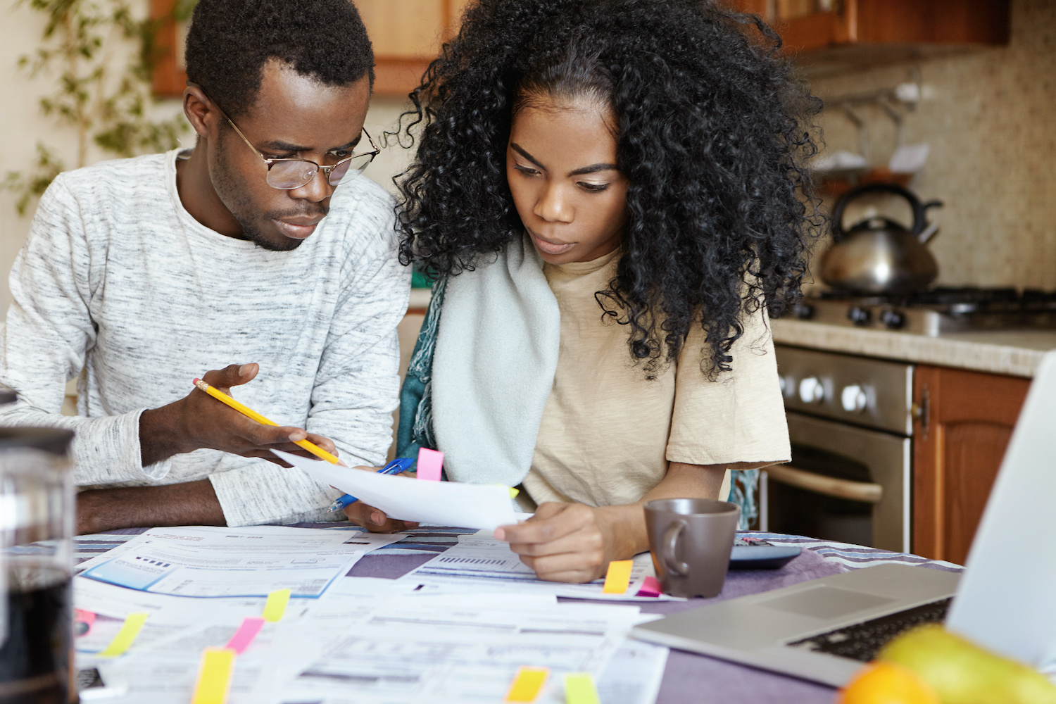 A couple looks over their tax forms