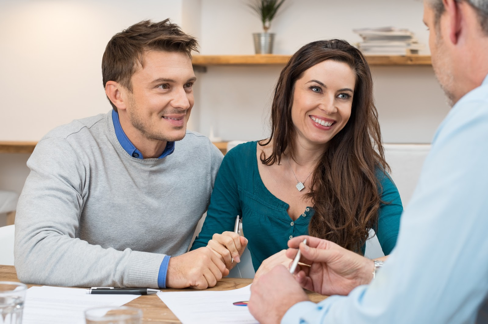 Does refinancing hurt your credit: A young couple meets with a financial adviser