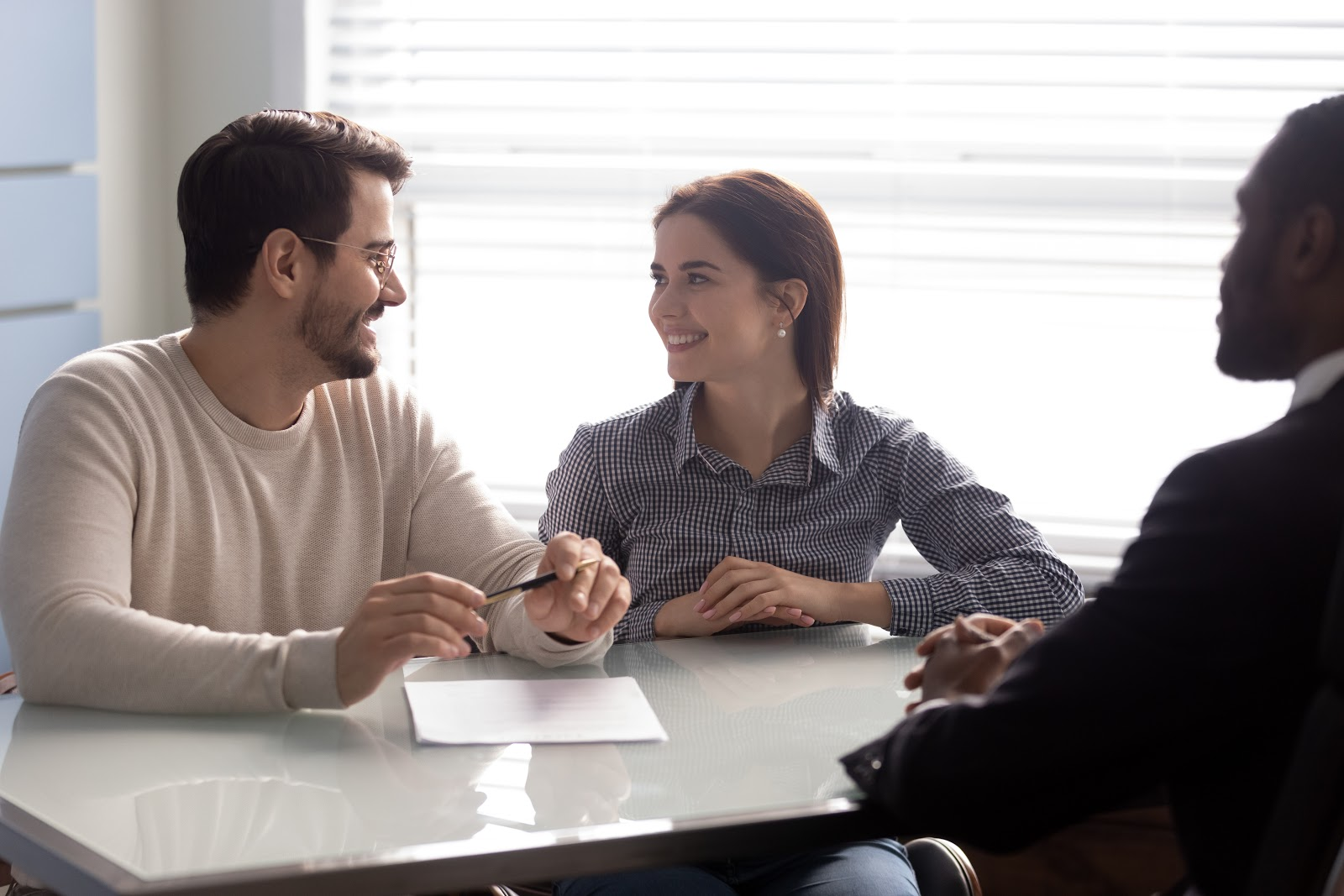 A couple talks with a financial planner