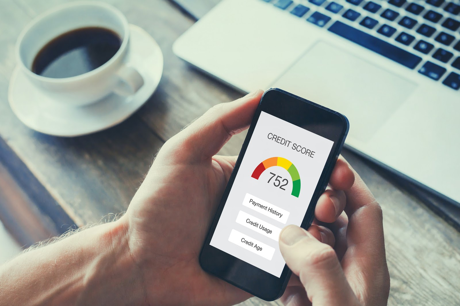 Two hands hold a smartphone and use a credit score app