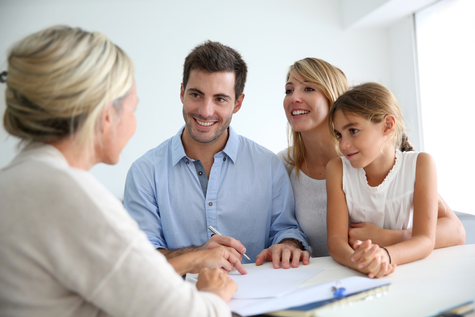 A family meets with a financial adviser