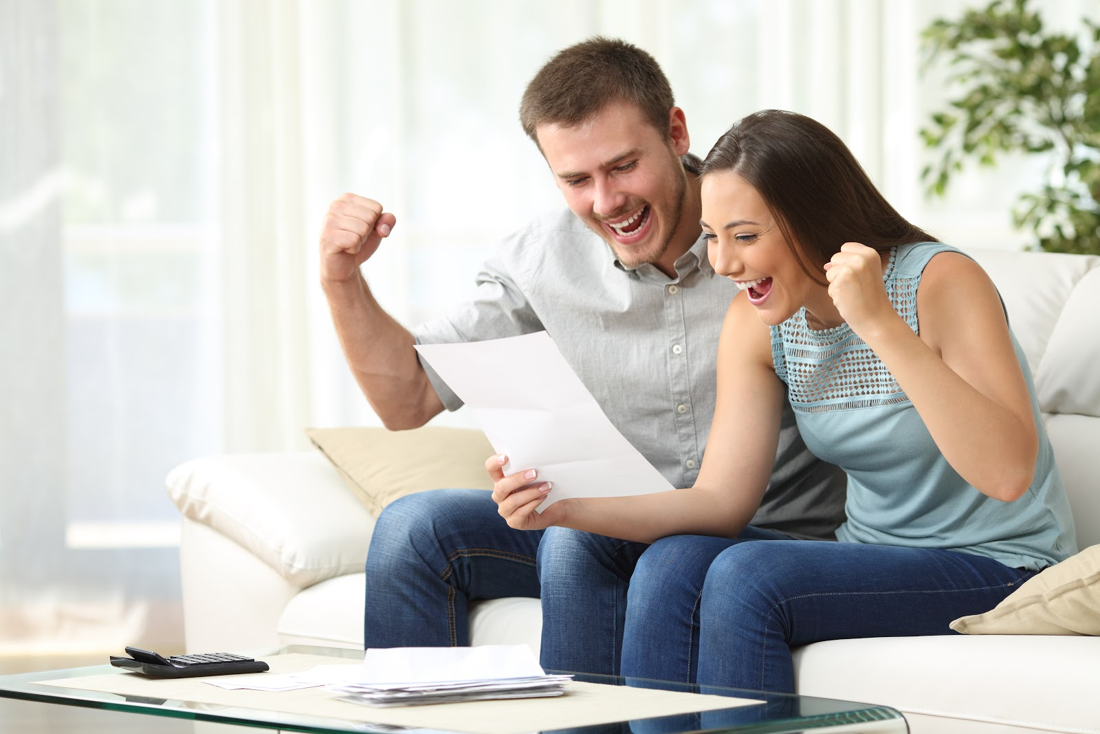 An excited couple looks at their tax refund
