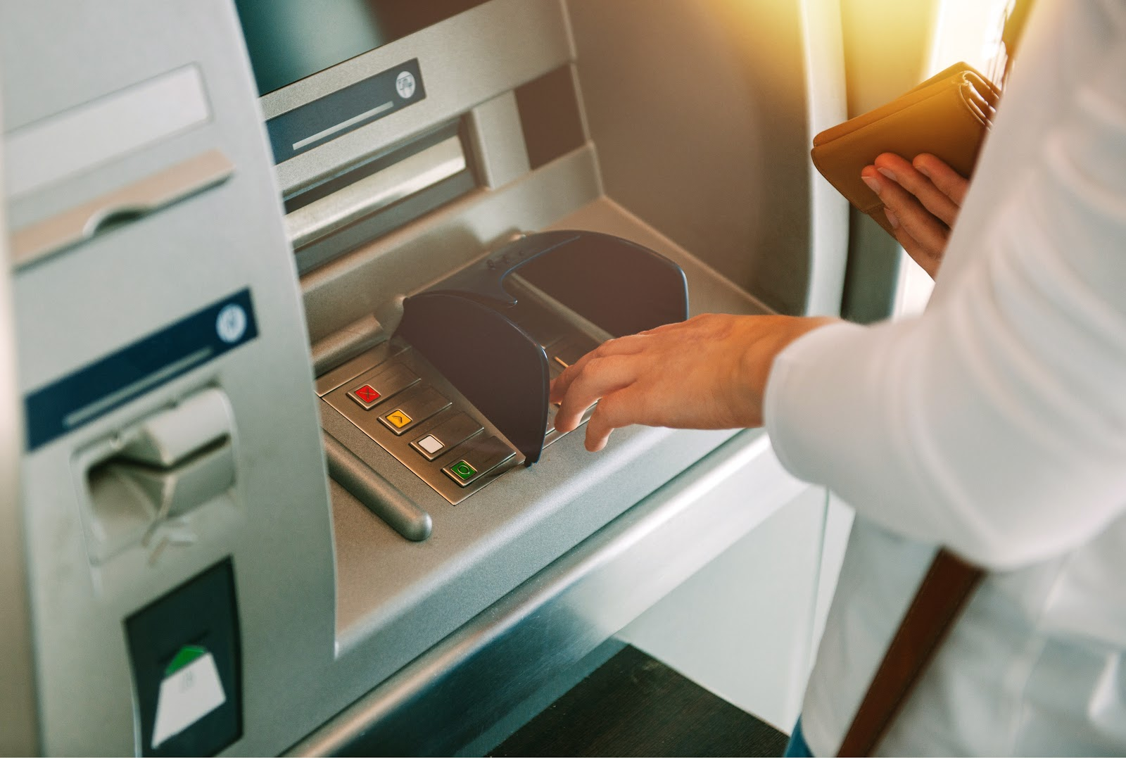 Secured line of credit: A woman takes a cash advance from an ATM