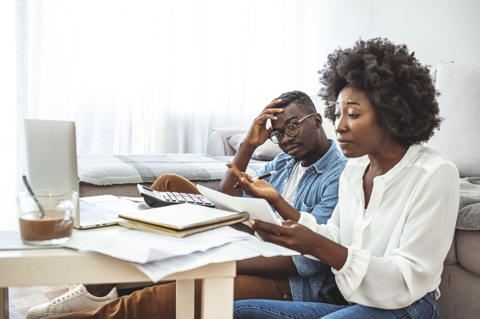 A couple looks over their bills