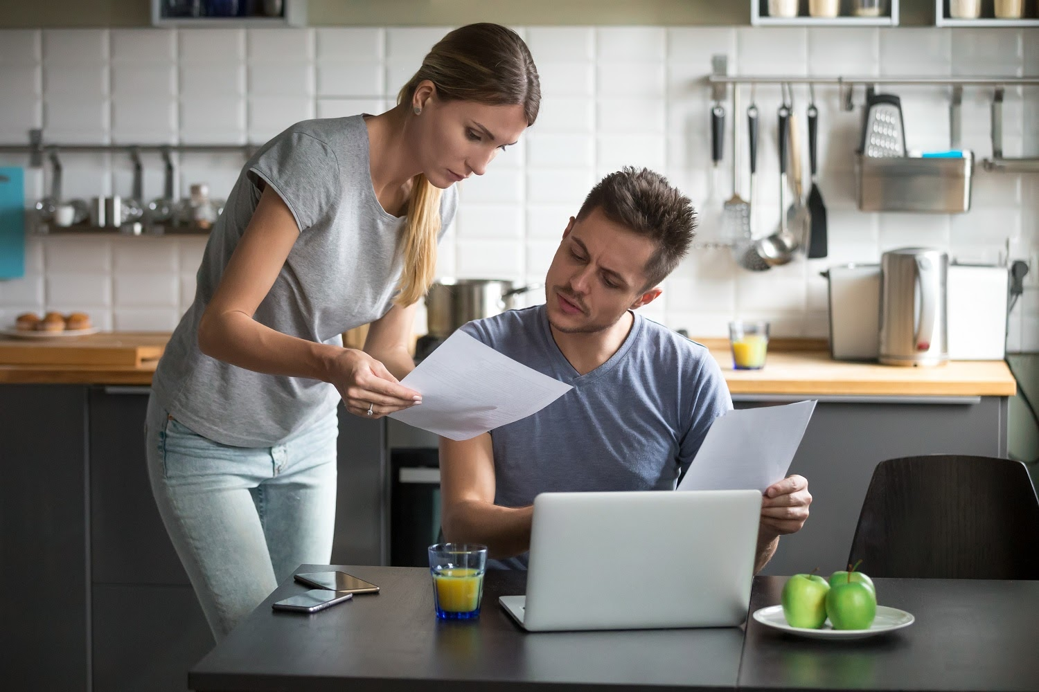 Can you pay rent with a credit card: A couple looks over their bills