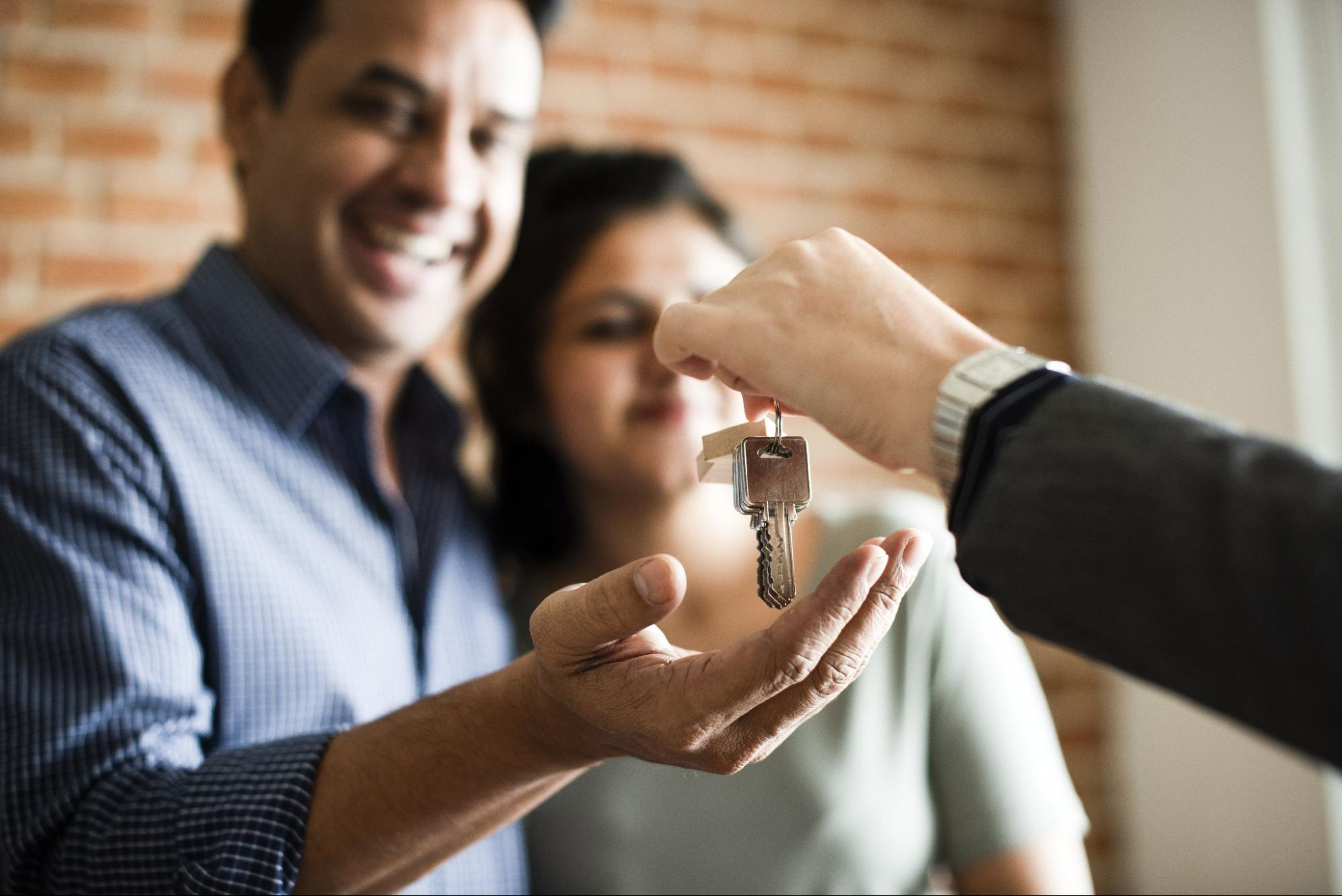 A couple receives their keys to a new home