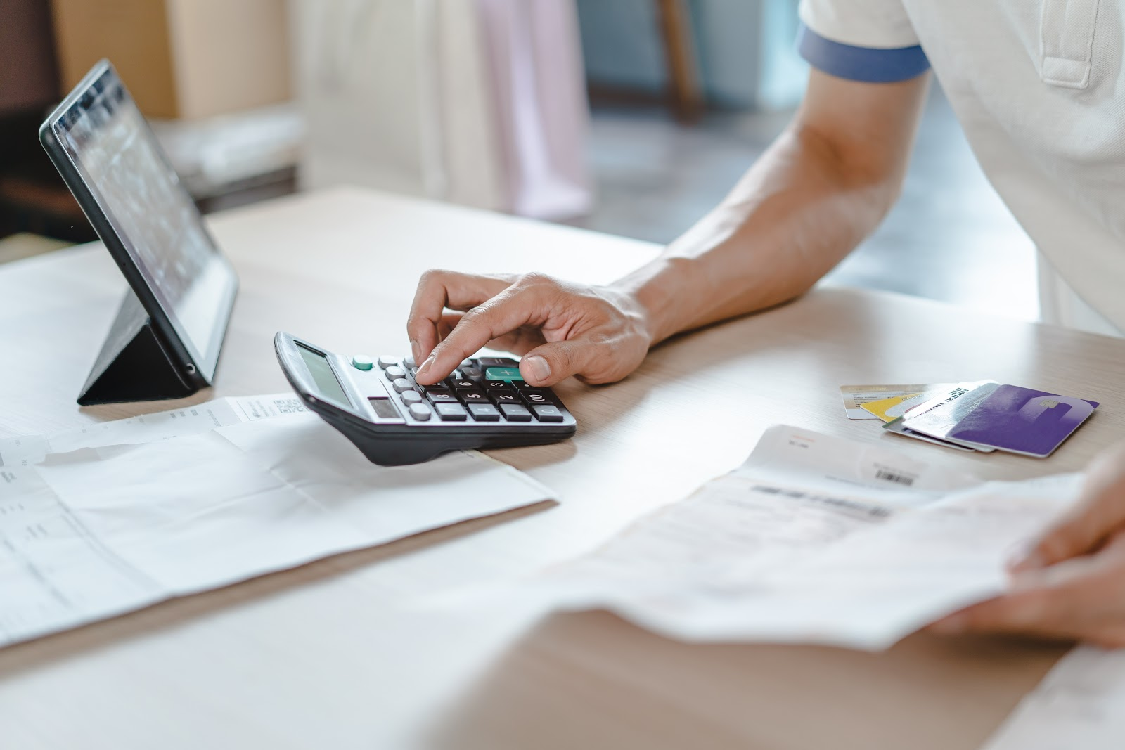 How to manage credit card debt: A close up of a person calculating their expenses