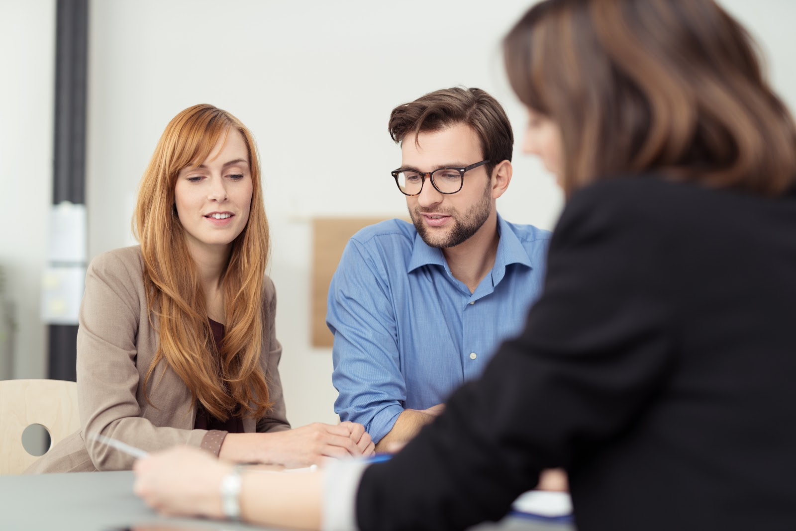 A couple meets with a credit counselor