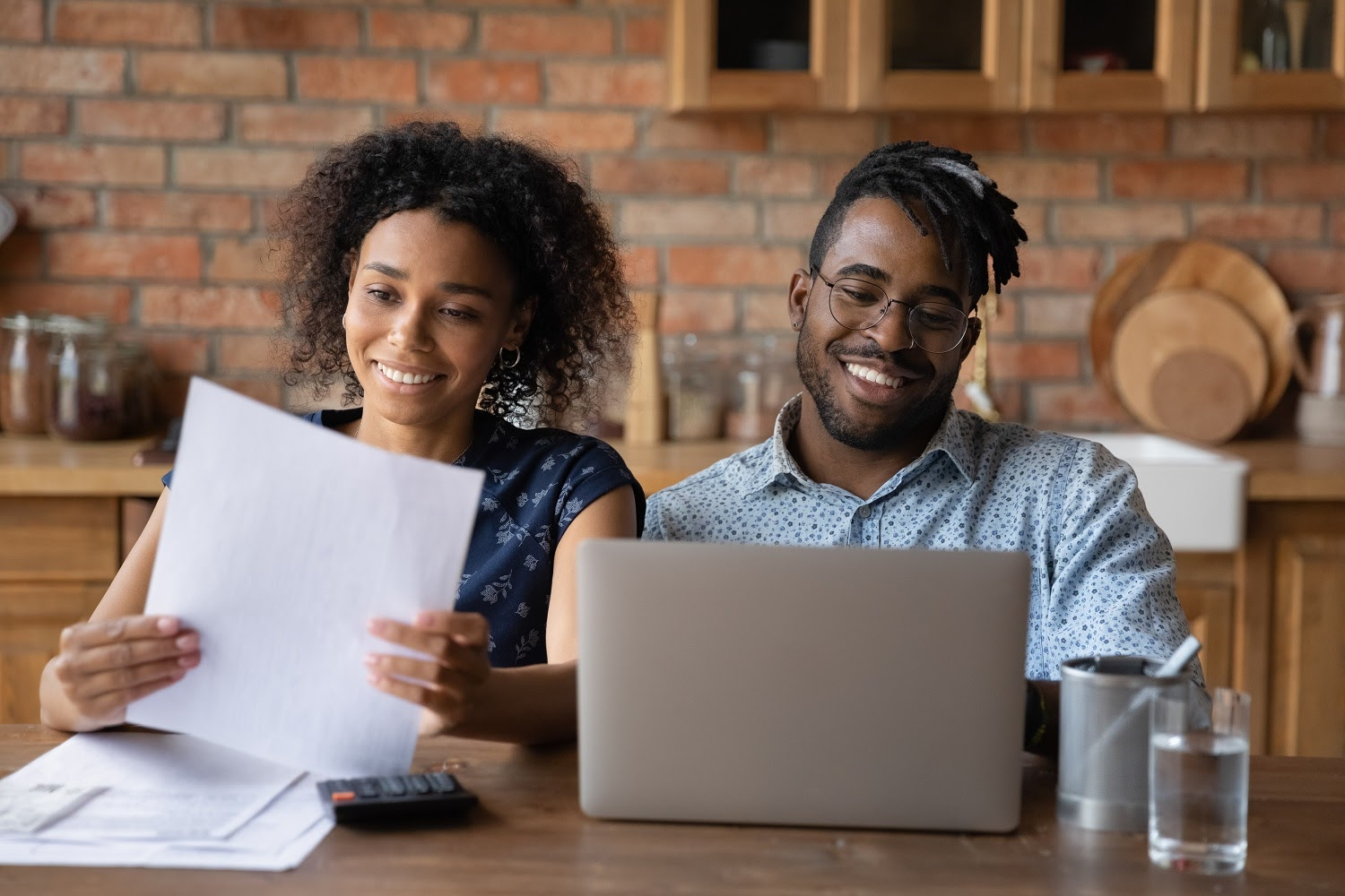 What is a certificate of deposit: A couple looks over their finances and uses a laptop
