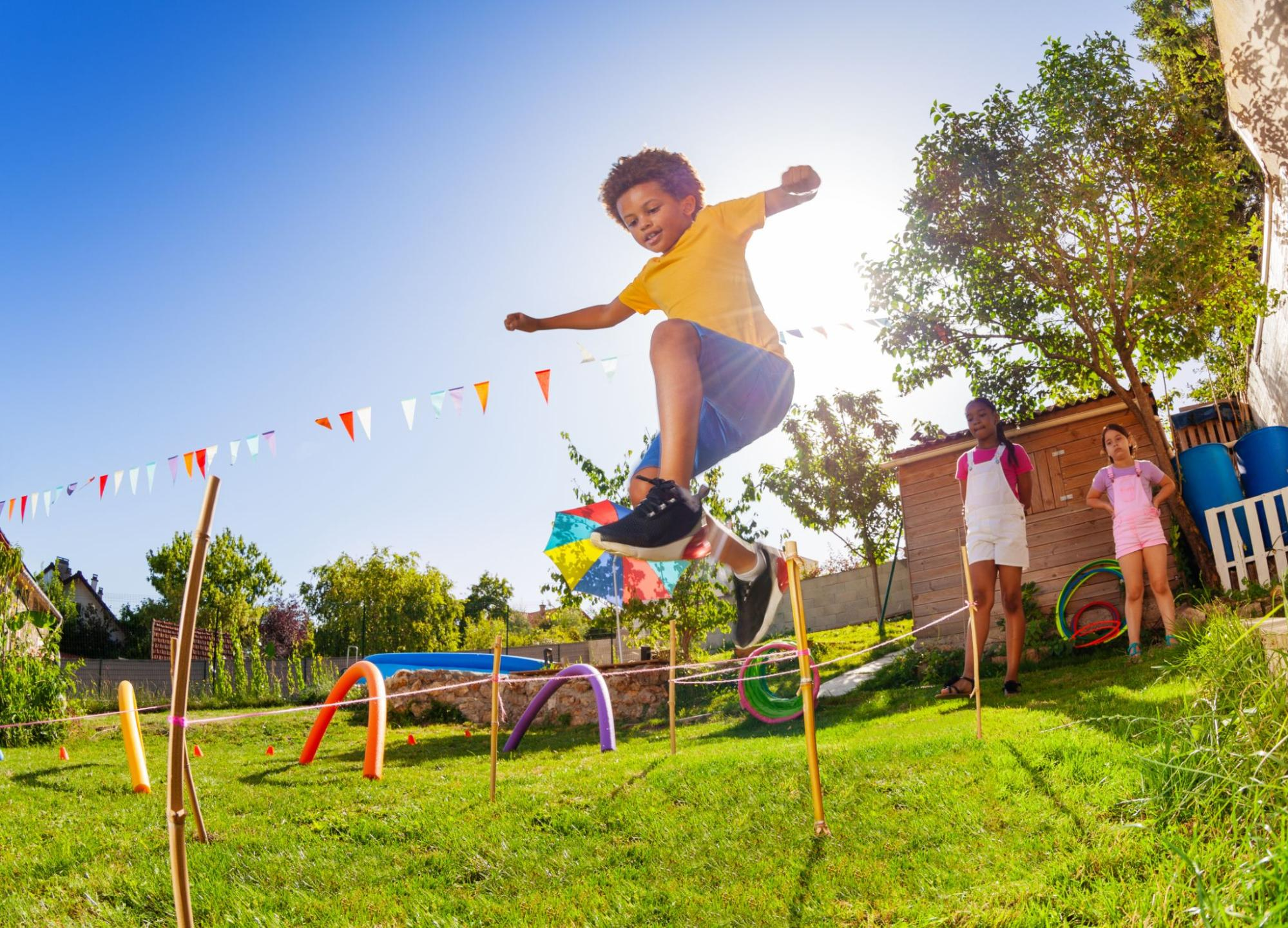 Family activities on a budget: A boy runs through an obstacle course