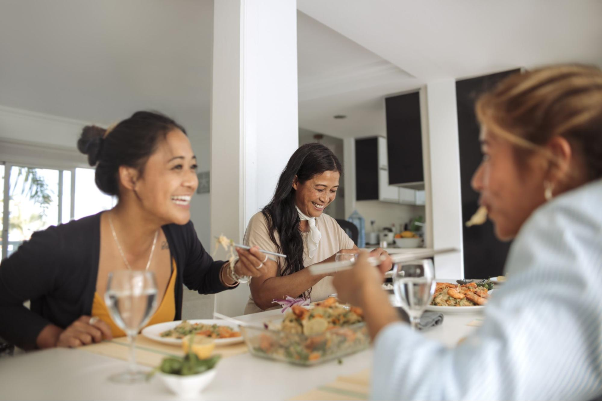Discretionary income: A family eats together at home