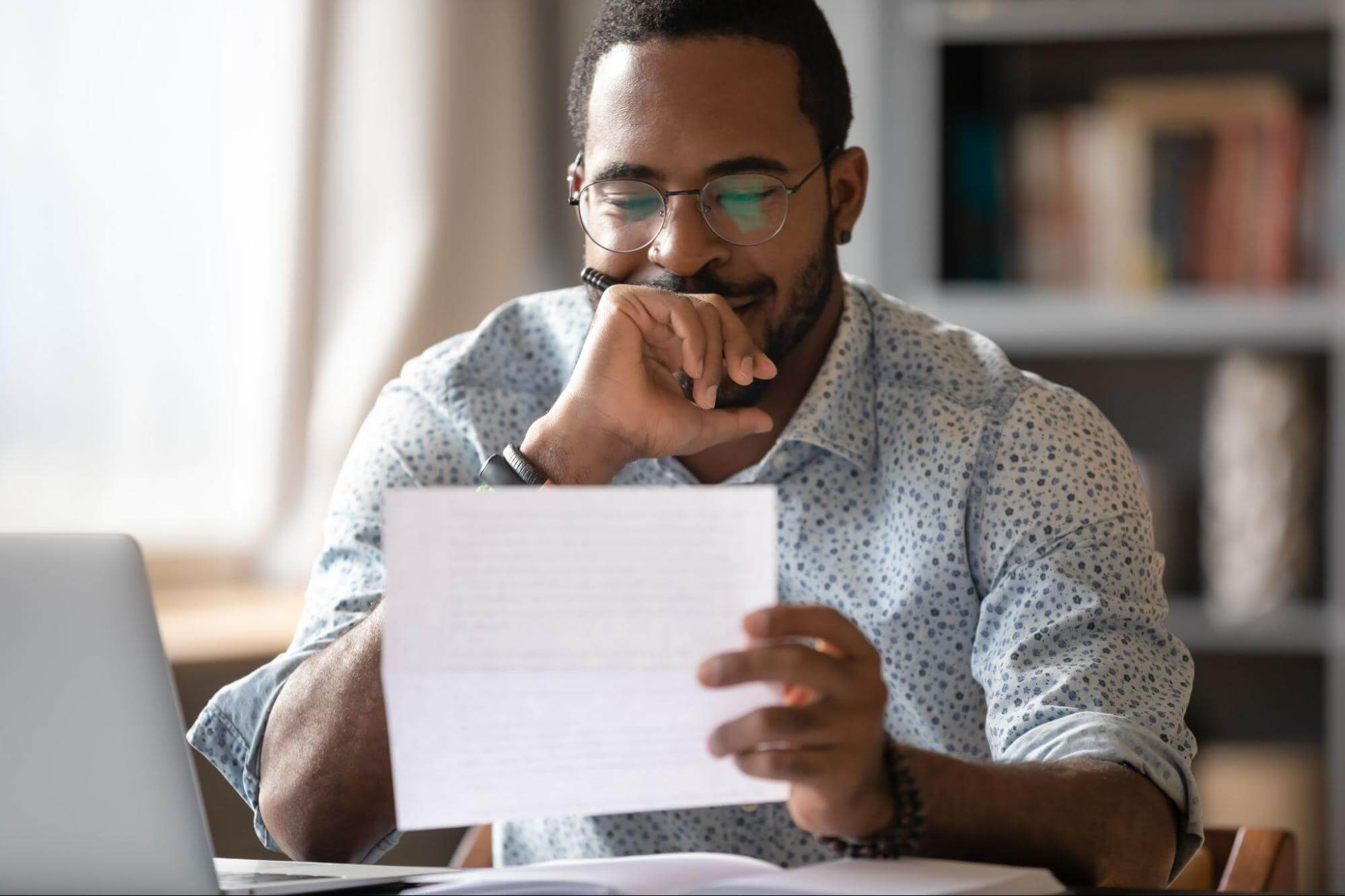 Types of budgets: A man looks over his budget