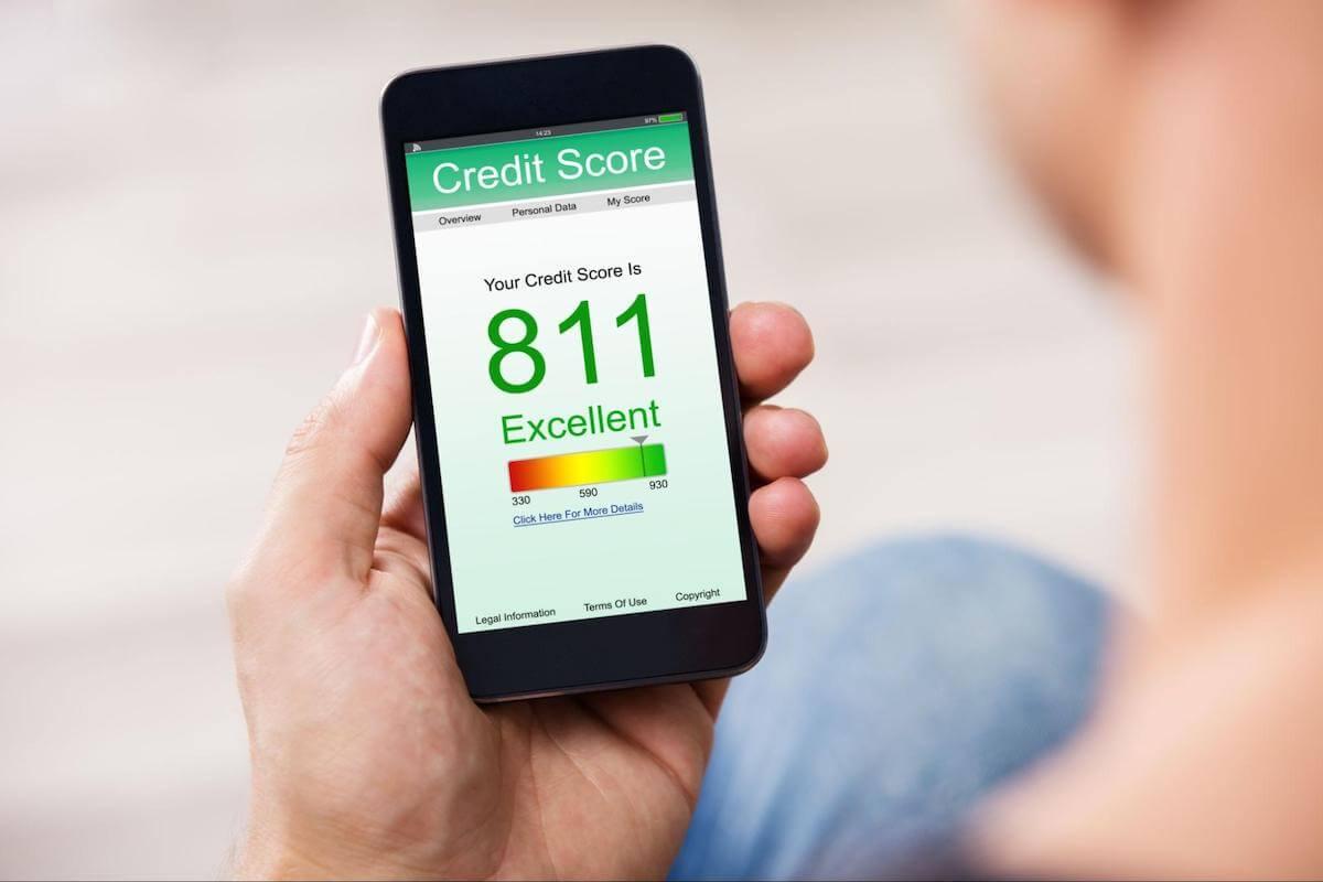How does affirm work: A person checks their credit score on their mobile phone