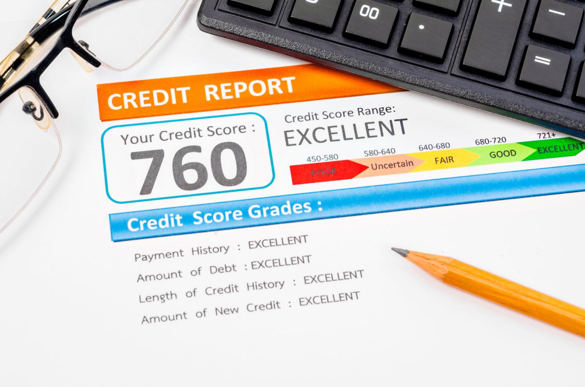Credit history: A printed credit report sits under a keyboard, a pencil, and a pair of glasses