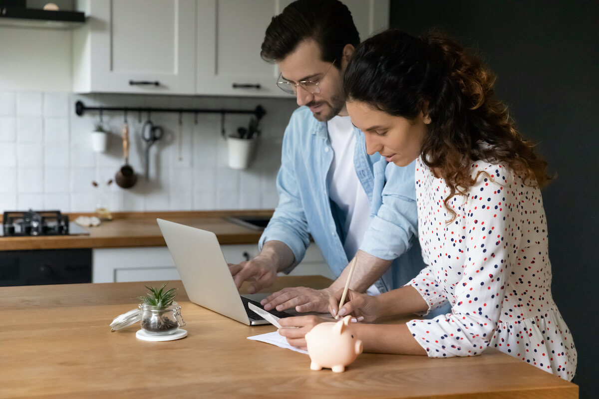 What are sub-zero interest rates: A couple looks over their finances on a laptop