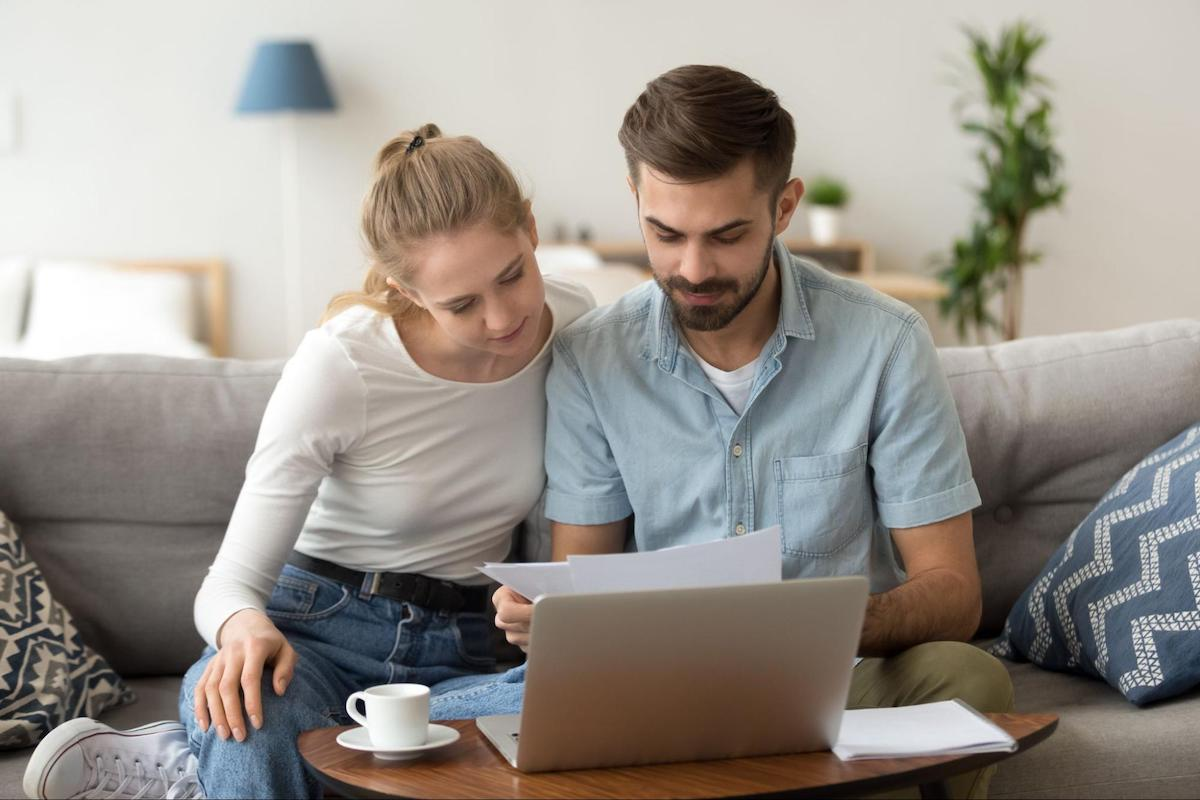 A couple looks at their credit report together