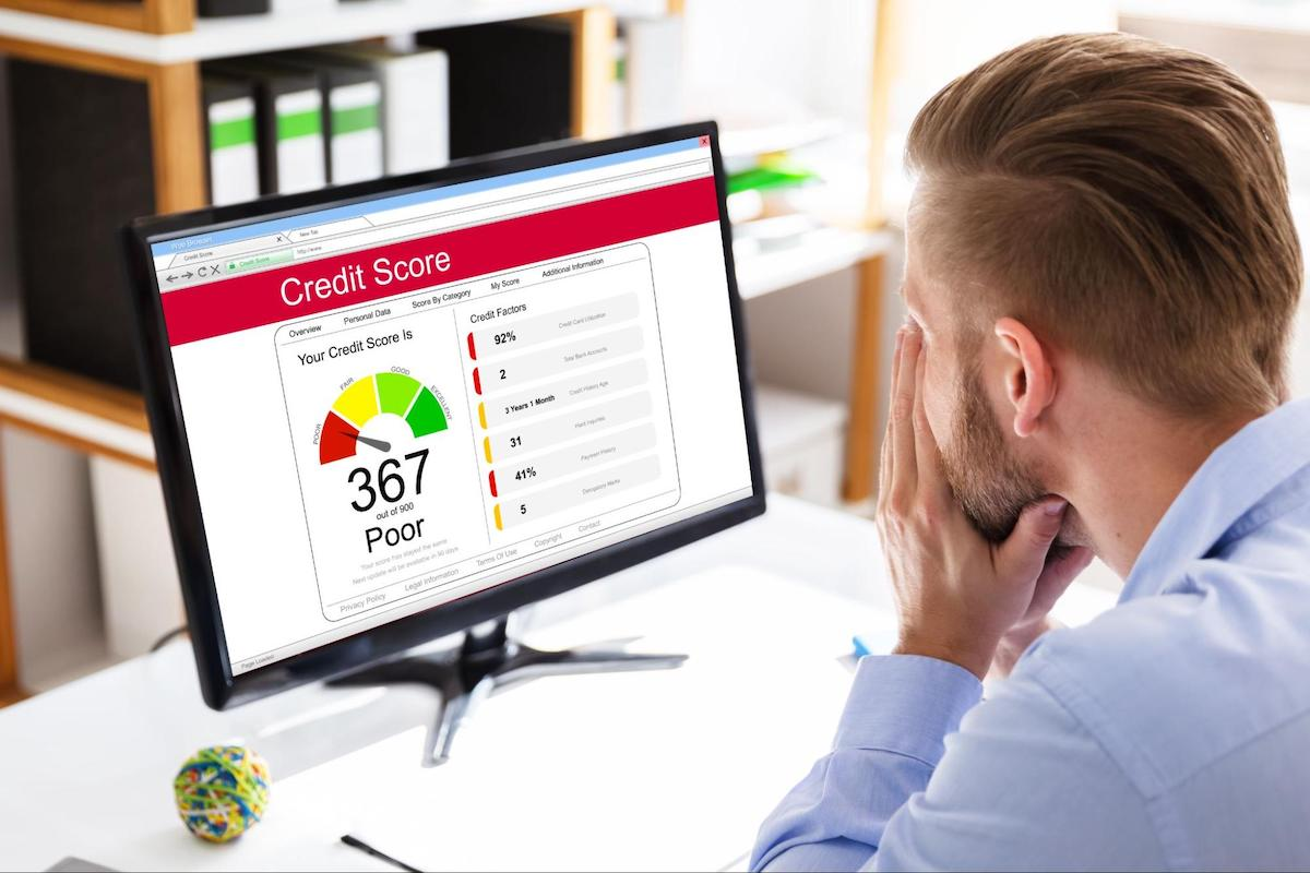 Can I get a line of credit with poor credit: A man checks his credit score on a computer
