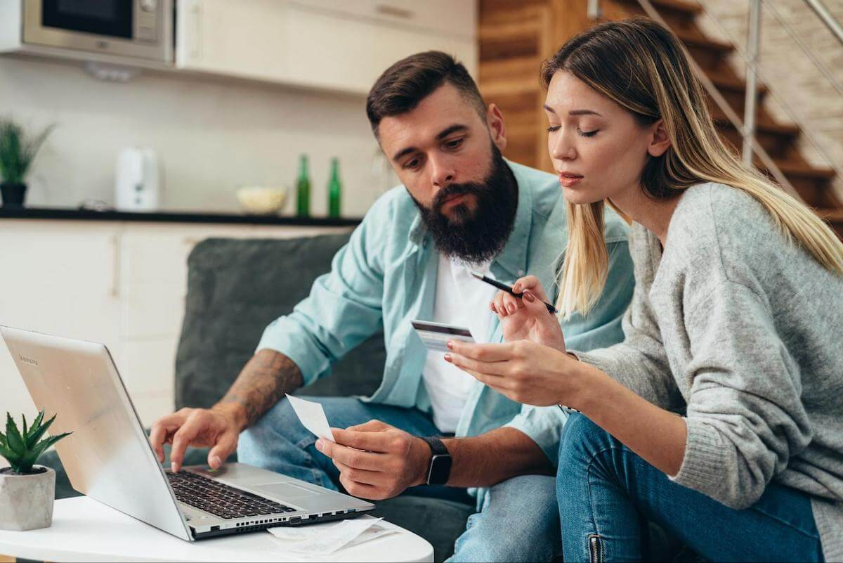 How to negotiate credit card debt: A couple reviews and discusses their finances at home