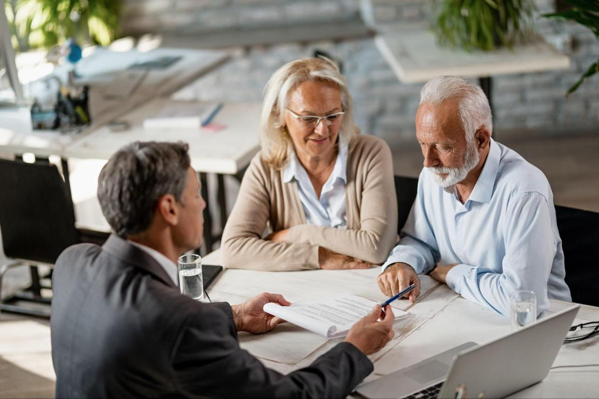 Is debt consolidation worth it: A couple meets with a lender